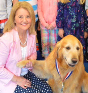 Care Dimensions pet therapy dog Patrick with hospice volunteer