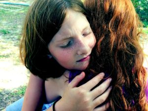 two teens hugging child grief support