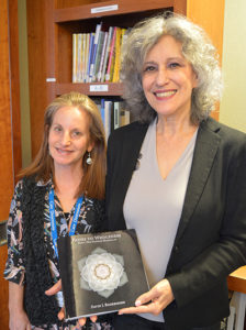 Barrie Levine donates book to Care Dimensions' Ellen Frankel at Kaplan Family Hospice House