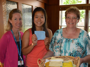 Bishop Fenwick High School Senior Joie Dillion delivers prayer squares to Care Dimensions Kaplan Family Hospice House