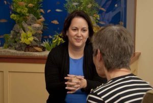 Care Dimensions hospice physician Stephanie Patel speaks with a patient