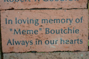 Inscribed brick honoring Meme Boutchie