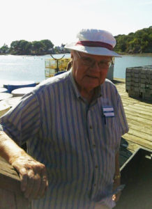 Care Dimensions hospice patient Bill McPherson waits for lobster boats to arrive at Beverly docks