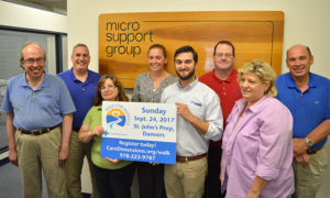 Bruce Billingham and employees of Micro Support Group promoting Care Dimensions' 30th Walk for Hospice