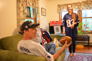 New England Patritos fan and Care Dimensions hospice patient Steve Brown catches football from daughter