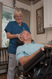 Hospice patient John Driscoll receives head and neck massage from Care Dimensions massage therapist