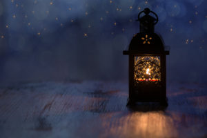 lantern with blue background and stars honoring memory of loved one who has died