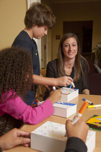Grieving children make memory boxes with Care Dimensions child life specialist
