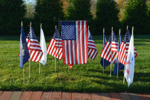 United States flags and other flags in Garden of Remembrance at the Care Dimensions Kaplan Family Hospice House
