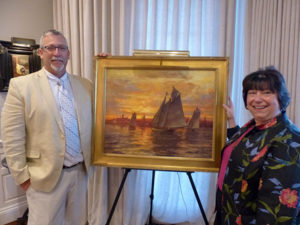 Rockport artist Ken Knowles with Care Dimensions President Pat Ahern and the painting Ken is donating to Care Dimensions 40th Anniversary Gala