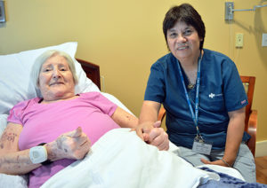 Care Dimensions Hospice Aide Cindy Berry with female patient at Kaplan Family Hospice House