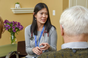 Anna-Chon-MD-Care-Dimensions-hospice-palliative-care-physician-consult-with-male-patient