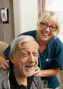 Care-Dimensions-Massage-Therapist-Nancy-Davan-rubs-shoulders-of-male-hospice-patient